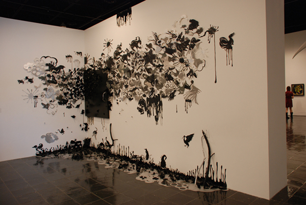 Leah Wong 'Vulnerable Planet' (2010) paper hand-cut papers, canvas, wood, plastic and enamel on wall and floor, various dimensions