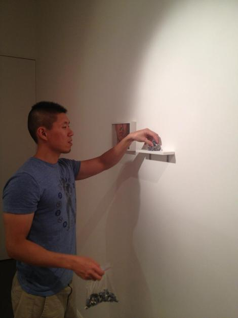 Artist Takming Chuang installing his work. Image copyright the gallery.