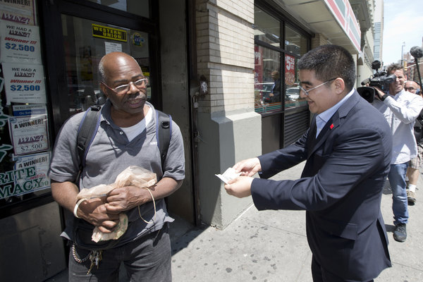 Chinese Millionaire handing out $100 bills in downtown Manhattan